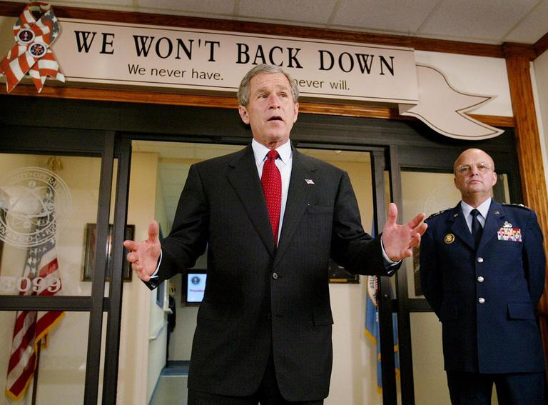 President Bush talks to reporters outside the National Security Operations Center as NSA  Director Lt. Gen. Michael Hayden looks on, in 2002. (AP)