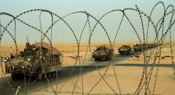 A column of U.S. Army Stryker armored vehicles cross the border from Iraq into Kuwait on Wednesday. The trucks are part of the last combat brigade to leave Iraq as part of the drawdown of U.S. forces. (AP)
