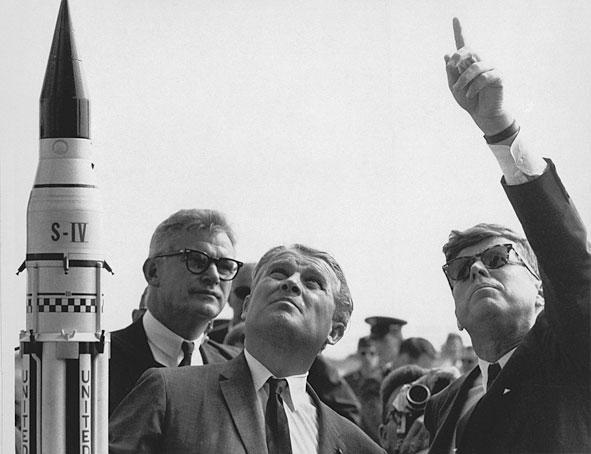 Dr. Wernher von Braun, center, explains the Saturn Launch System to President John F. Kennedy in 1963 as NASA Deputy Administrator Robert Seamans looks on. (NASA)