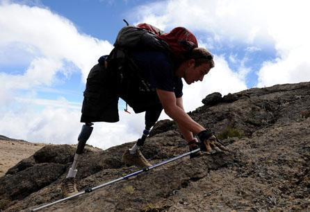 Neil Duncan makes his way slowly towards the summit of Mt Kilimanjaro in Tanzania, on the fourth day of his climb. Duncan lost his legs in Afghanistan. (AP/Courtesy of Disabled Sports USA)
