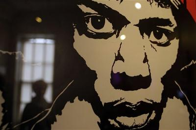 A vintage concert poster depicting late US musician Jimi Hendrix, is seen in a exhibition at the Handel House Museum. (AP)