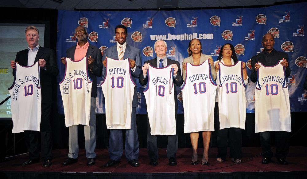 The Naismith Memorial Basketball Hall of Fame class poses with jerseys on April 5 in Indianapolis. Recipients included Larry Bird, representing the 1992 USA Olympic team and Walt Bellamy, representing the 1960 Olympic team. (AP)