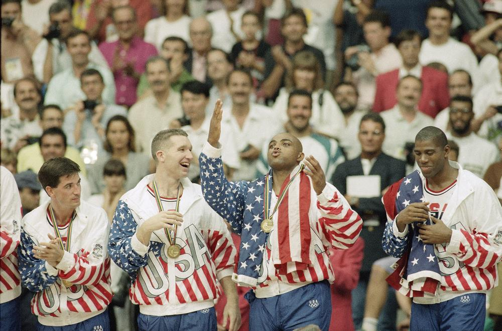 The 1992 USA Olympic basketball team rejoices after winning the gold-medal game against Croatia. (AP)