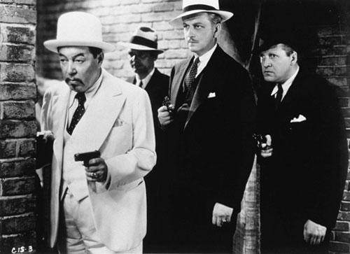 At left, Charlie Chan played by Warner Oland (Fox Home Entertainment)