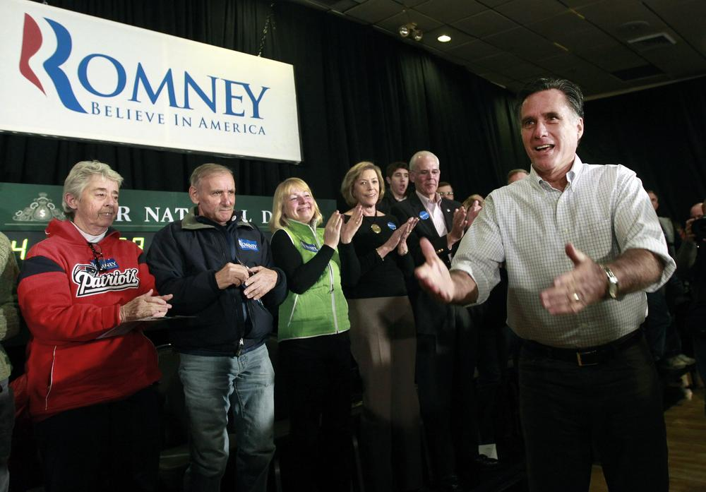 Mitt Romney reacts as he enters a town meeting in Manchester, N.H. (AP)