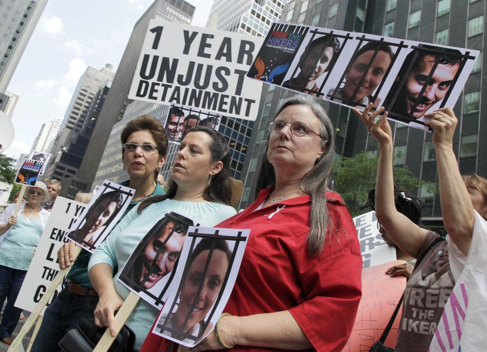 Laura Fattal, left, Cindy Hickey, and Nora Shourd, mothers of three American hikers jailed in Iran, participate in a demonstration outside Iran's mission to the United Nations. (AP)