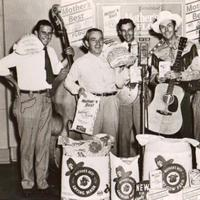 Hank Williams with his band, and bags of sponsor's Mother's Best flour. (Courtesy of Missing Piece Group)