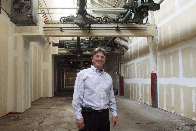 Dennis Guberski, CEO of Biomedical Research Models in Worcester, is turning an empty Worcester factory into a cutting-edge research lab. (Jess Bidgood for WBUR)