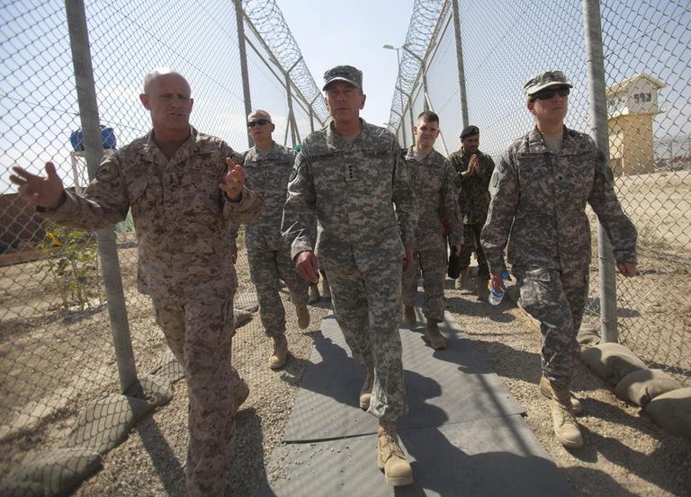 Gen. David Petraeus, center, tours the grounds of the U.S.-run Parwan detention facility near Bagram north of Kabul, Afghanistan, in September. (AP)