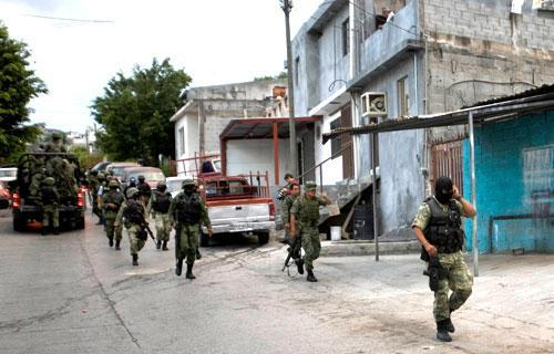Soldiers patrol a neighborhood after a shoot out between rival gangs in Monterrey, Mexico, Oct. 5, 2010. (AP)