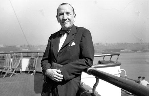 British actor, composer and playwright Noël Coward poses aboard the Queen Elizabeth ocean liner in 1947. (AP)