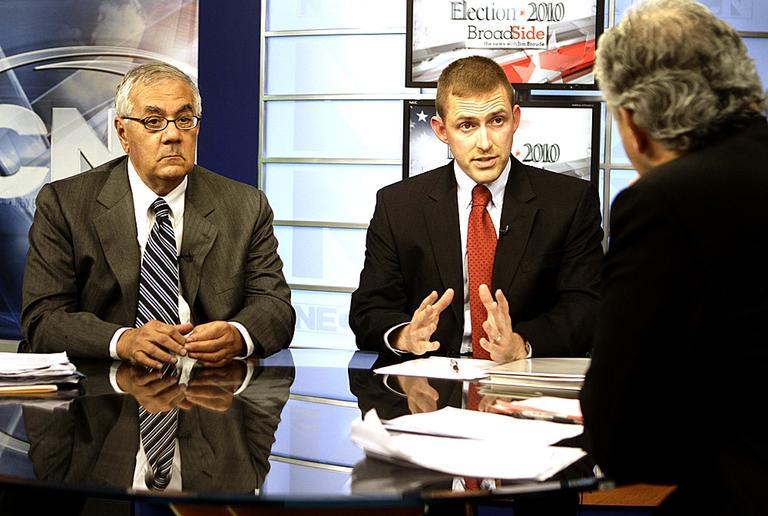 Democrat Rep. Barney Frank, left, and Republican challenger Sean Bielat, center, debate on October 11. (AP)