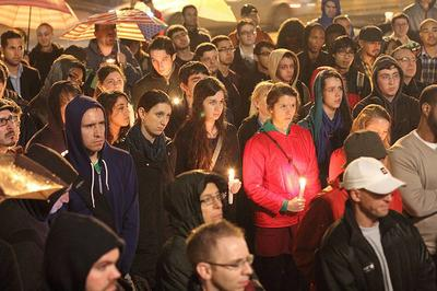 The crowd at a vigil for LGBT Suicide Victims outside the Massachusetts State House on October 5. (Courtesy of Join The Impact MA)