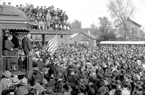 U.S. President Herbert Hoover campaigns for re-election from the rear of the presidential train in 1932. (AP)