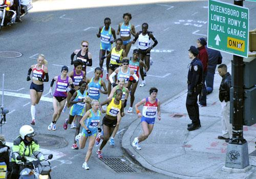 The elite women runners make the turn the corner of 59th Street during the New York City Marathon, Nov. 7, 2010. (AP)