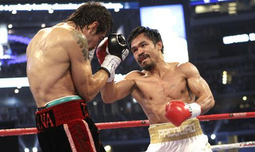 Manny Pacquiao, right, lands a blow against Antonio Margarito, on his way to victory in their title boxing match, Nov. 13, 2010, in Texas. (AP)