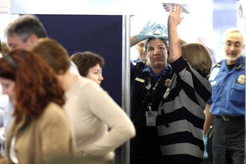 An airline passenger undergoes a full body scan at O'Hare International Airport, Nov. 17, 2010 in Chicago. (AP)