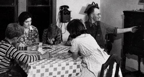 A family listens to the radio in this 1933 photo. Location unknown. (AP Photo)