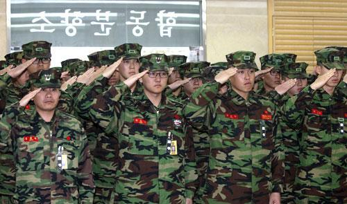 South Korean marines salute their fellow troops killed in a North Korean bombardment, during a memorial service in South Korea, Nov. 24, 2010. (AP)