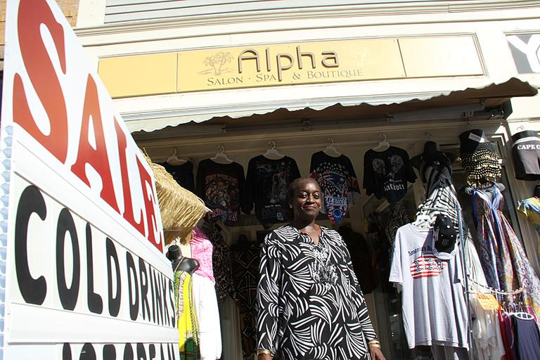 Maureen Idehen owns a boutique in downtown Plymouth. As the number of tourists visiting Plymouth dwindled, Idehen admits this past year has been tough — her sales have fallen by one-third. (Kirk Carapezza for WBUR)
