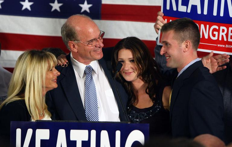 Democratic candidate for the 10th Congressional District, Bill Keating, celebrates his victory with his wife, Tevis, left, his daughter, Kristen, and his son, Patrick, in Quincy, Tuesday. (AP)