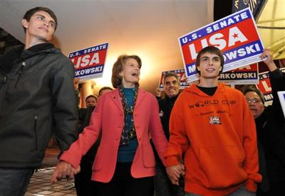 At center, United States Senator Lisa Murkowski (R) Alaska walks to Anchorage, Alaska's election central with sons Nick, left and Matt. (AP)