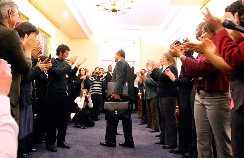 Gov. Deval Patrick's staff applauded as he entered his State House office on Wednesday. (Bizuayehu Tesfaye/AP)