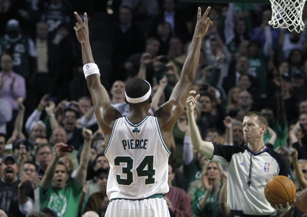 Boston's Paul Pierce celebrates after making his 20,000th career point on a free throw in overtime during an NBA basketball game against Milwaukee Bucks on Wednesday in Boston. The Celtics won 105-102. (AP)