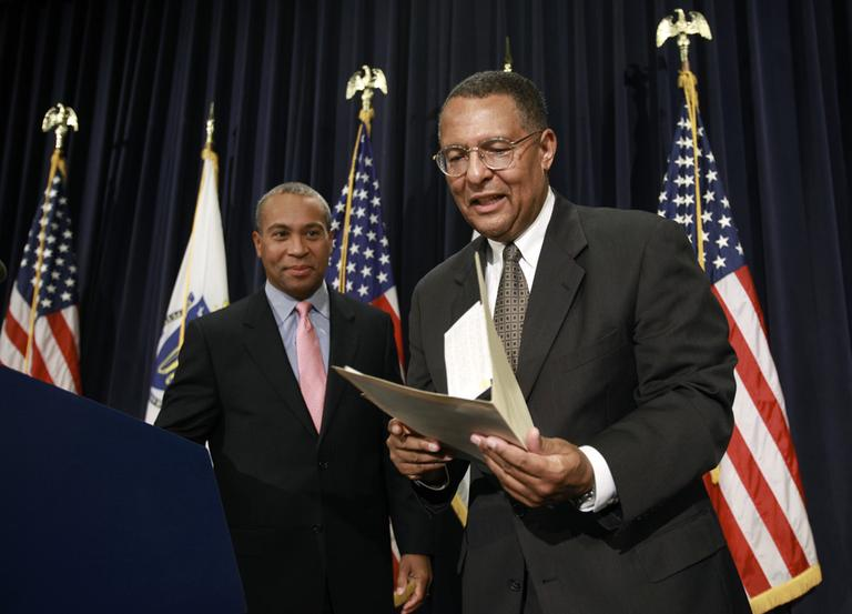 Gov. Deval Patrick, left, and Massachusetts Supreme Court Associate Justice Roderick Ireland depart the stage following a news conference at the Statehouse in Boston, Thursday. (AP)