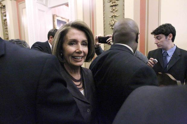 Speaker Nancy Pelosi heads through the Capitol for a TV interview Wednesday, the day after House Democrats sustained huge election losses. (AP)