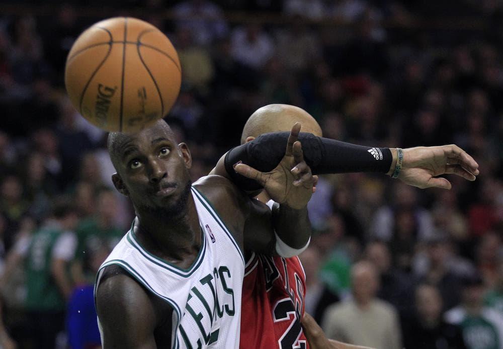 Kevin Garnett, left, blocks out Chicago Bulls forward Taj Gibson, right, during their game in Boston, Friday (AP Photo/Charles Krupa)