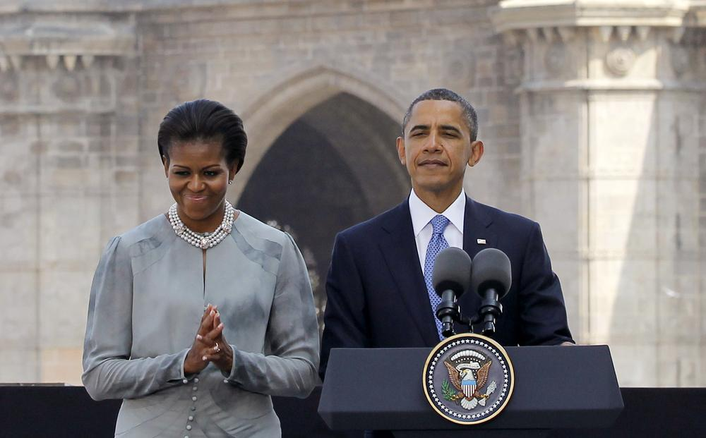 President Barack Obama and first lady Michelle Obama make a statement after their visit the memorial for the Nov. 26, 2008 terror attack victims at the Taj Mahal Palace and Tower Hotel in Mumbai, India, Saturday, Nov. 6, 2010. (AP Photo/Charles Dharapak)
