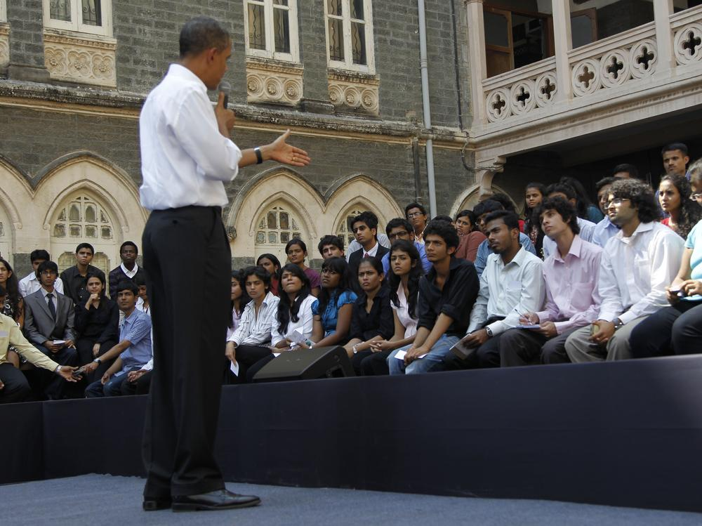 President Barack Obama on stage as he answers questions during a town hall meeting with students at St. Xavier's College in Mumbai, India, Sunday. (AP Photo/Pablo Martinez Monsivais)