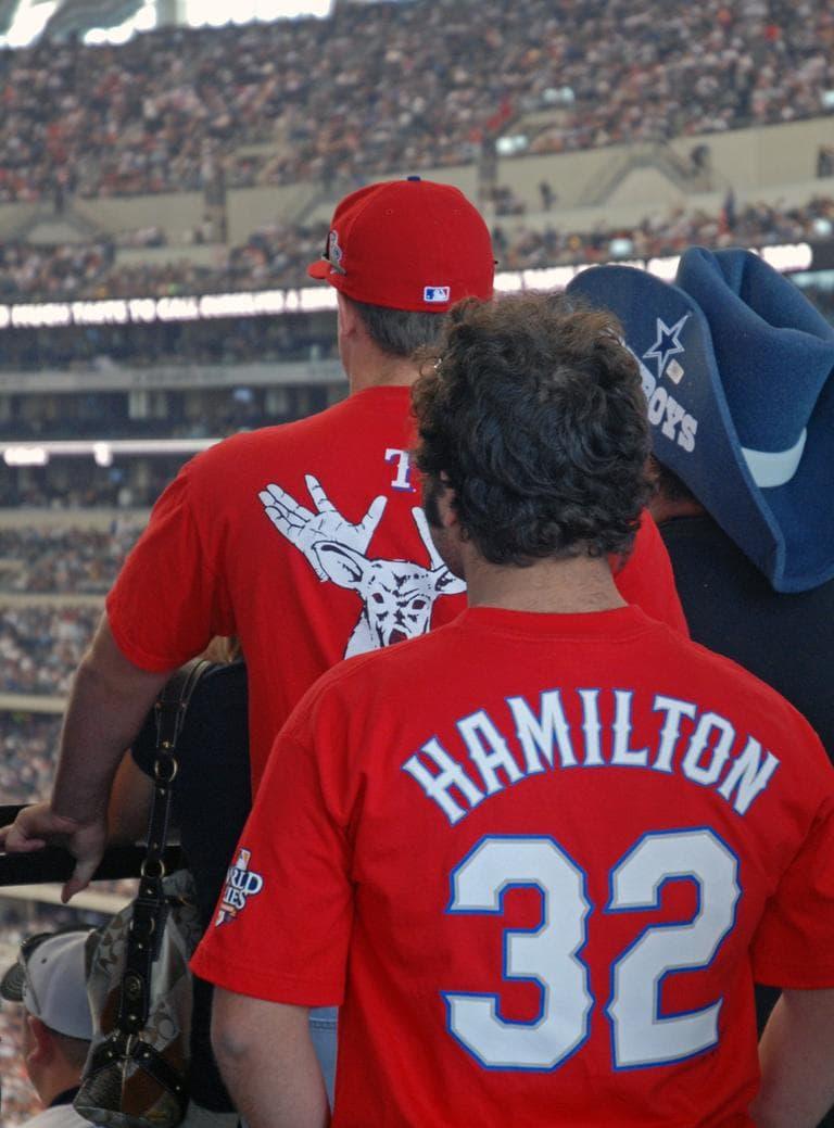 At Cowboys Stadium, some fans show their loyalties for both Dallas teams. (Karen Given/WBUR)
