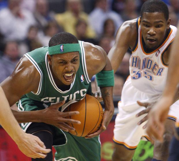 Boston forward Paul Pierce, left, drives past Oklahoma City forward Kevin Durant during the second quarter of the game in Oklahoma City on Sunday. (AP)