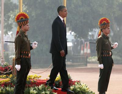 President Obama walks out to begin to review the honor guard during an arrival ceremony at Rashtrapati Bhavan in New Delhi, India, Monday. (AP)