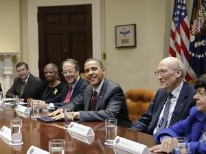 President Obama meets with members of the fiscal responsibility commission in April. (AP)