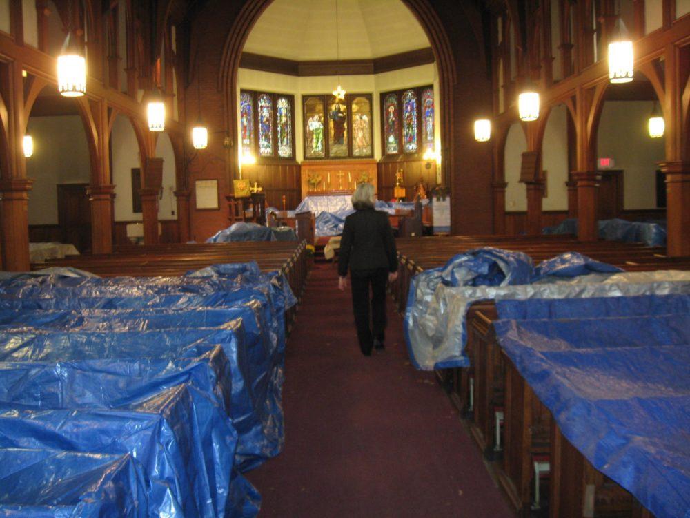 Rev. Cathy George inside St. Mary's Episcopal Church as it undergoes a renovation. (Adam Ragusea/WBUR)
