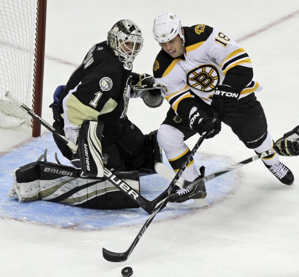 Boston's Nathan Horton can't get a shot off in front of Pittsburgh goalie Brent Johnson (1) during the first period of the game in Pittsburgh on Wednesday. The Bruins won 7-4. (AP)