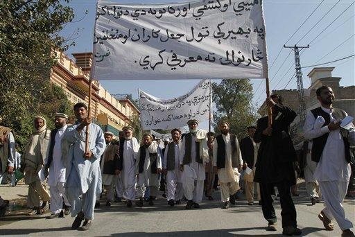 Supporters of former legislators carry banners calling for the Afghan government to clamp down on fraud as they protest against the recent parliamentary elections, in Jalalabad, east of Kabul, Afghanistan. (AP)