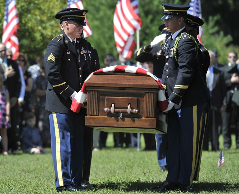 Connecticut Army National Guard Military Funeral Honors Team carry the casket of Army Sgt. Steven J. DeLuzio during funeral services in Glastonbury, Conn., Monday, Aug. 30, 2010.  (AP)