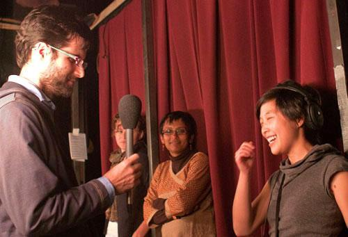 """Performer David Dougan, left, at a """"Mortified"""" event in Boston, with On Point producer Pien Huang, Nov. 5, 2010. (WBUR/Mackenzie Knowles-Coursin)"""