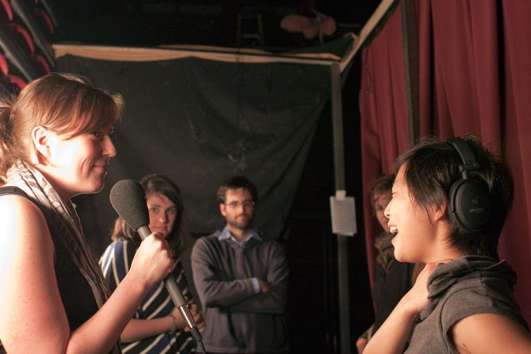 "Performer Caitlin Schwager, left, at a ""Mortified"" event in Boston, with On Point producer Pien Huang, far right, Nov. 5, 2010. (Mackenzie Knowles-Coursin for WBUR)"