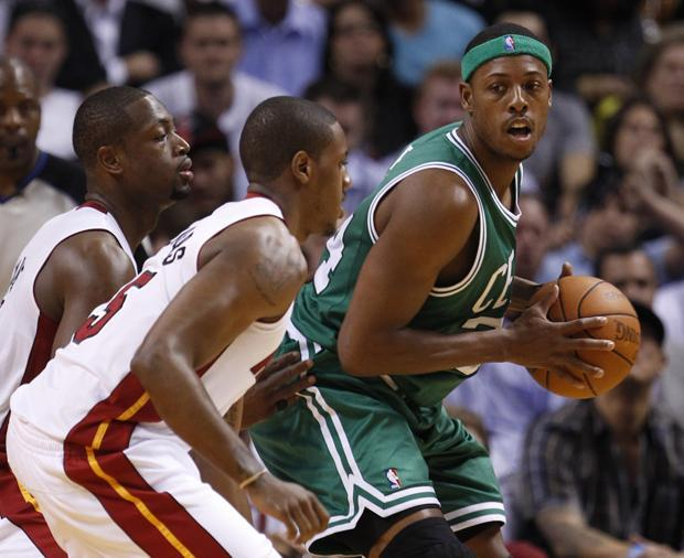 Boston forward Paul Pierce, right, looks for an opening past Miami shooting guard Dwyane Wade, left, and shooting guard Jerry Stackhouse during the first half of the game on Thursday in Miami. (AP)