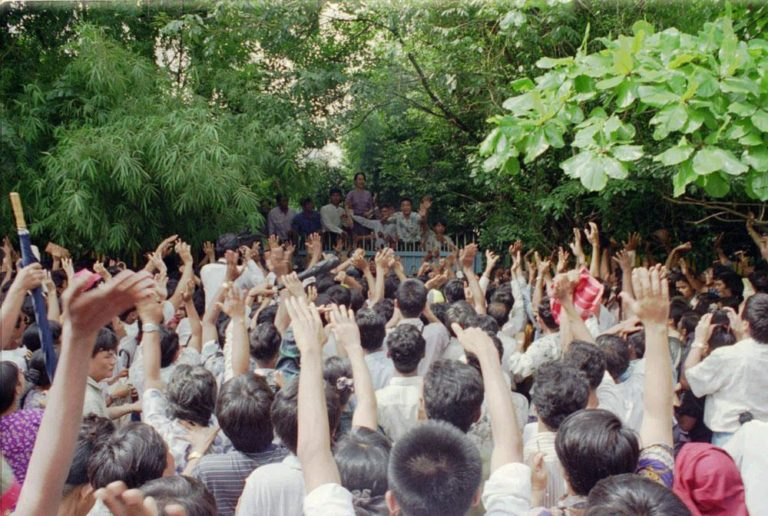 Burmese pro-democracy leader Aung San Suu Kyi is greeted by jubilant crowd on Tuesday, July 11, 1995 after she was released from house arrest in Rangoon. (AP)