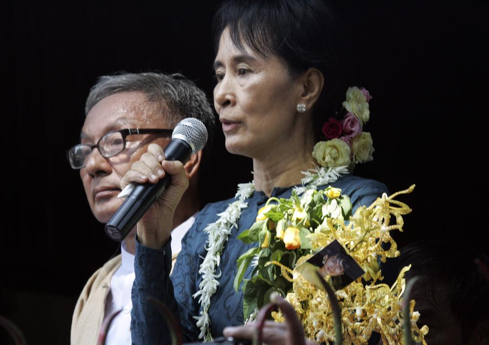Myanmar pro-democracy leader Aung San Suu Kyi delivers a speech to supporters at the headquarters of her National League for Democracy Party on Sunday.  (AP Photo/Khin Maung Win)