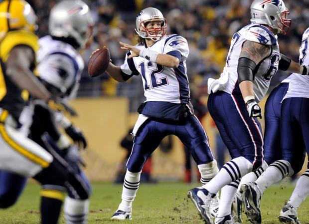 New England quarterback Tom Brady (12) drops back to pass during the fourth quarter of the game against Pittsburgh on Sunday in Pittsburgh. New England won 39-26.(AP)