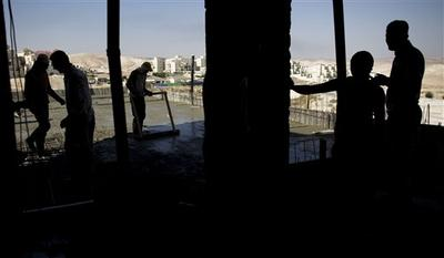 Palestinian men work on a construction site in the West Bank Jewish settlement of Maale Adumim, near Jerusalem. (AP)