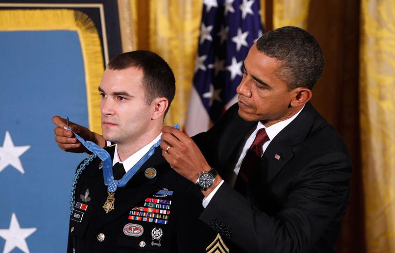 President Obama presents the Medal of Honor to Army Staff Sgt. Salvatore Giunta during a ceremony in the East Room of the White House on Tuesday. (AP)