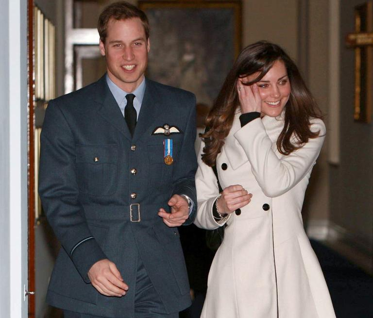 In this April 11, 2008 file photo, Britain's Prince William and his girlfriend, Kate Middleton, walk together at RAF Cranwell, England, after William received his RAF wings from his father, the Prince of Wales. (AP)